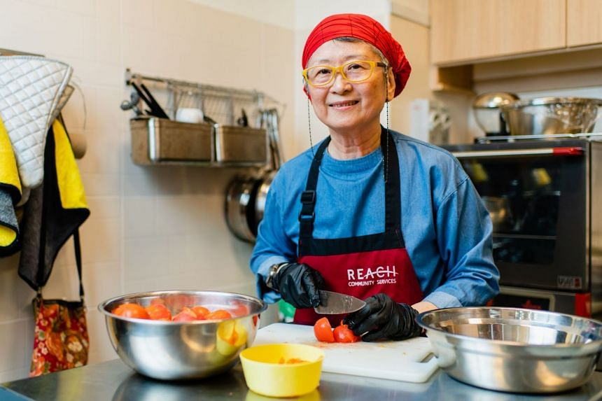 Since volunteering at REACH Community Cafe, Madam Yang has led a happier, more active and more social life.