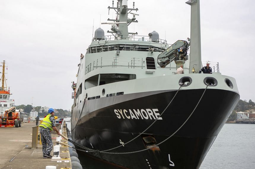 In a photo from Jan 1, 2020, the MV Sycamore departs from a naval base in Sydney.
