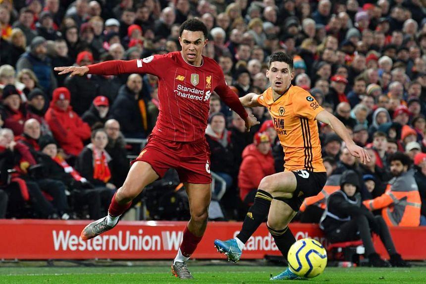 Liverpool's Trent Alexander-Arnold (left) in action against Wolverhampton Wanderers, on Dec 29, 2019.