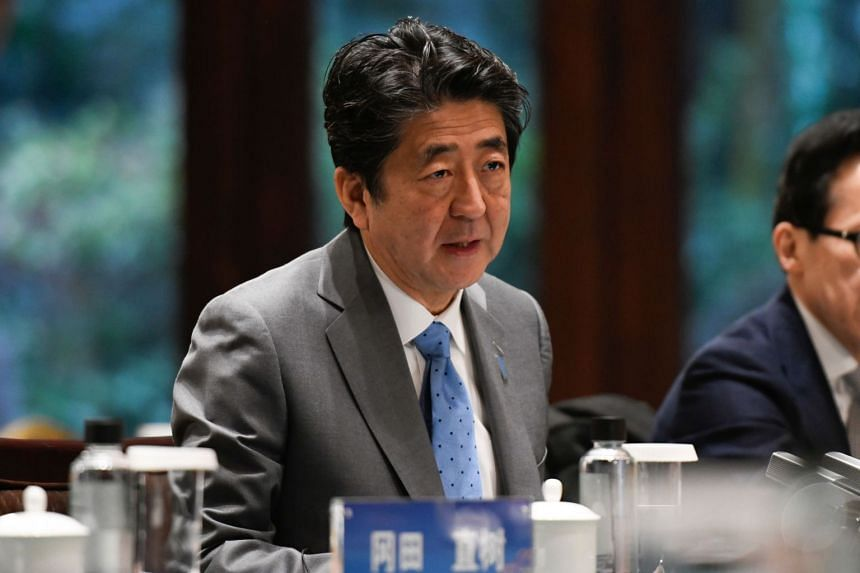 In a photo taken on Dec 25, Japan's Prime Minister Shinzo speaks during a meeting in China.