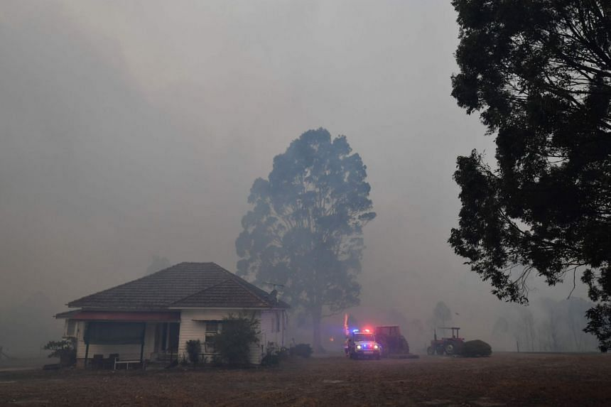 Emergency and fire services survey the area as smoke from nearby bushfires fill the sky around Nowra, New South Wales, on Dec 31, 2019.