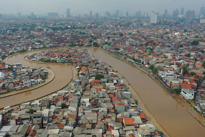 An aerial picture of an area affected by floods in Jakarta, next to Ciliwung river, on Jan 2, 2020.