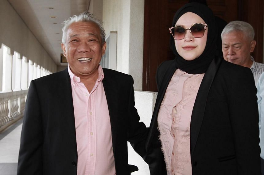 Umno supreme council member Bung Moktar Radin and with his wife Zizie Ezette Abd Samad outside the Sessions Court in Kuala Lumpur.