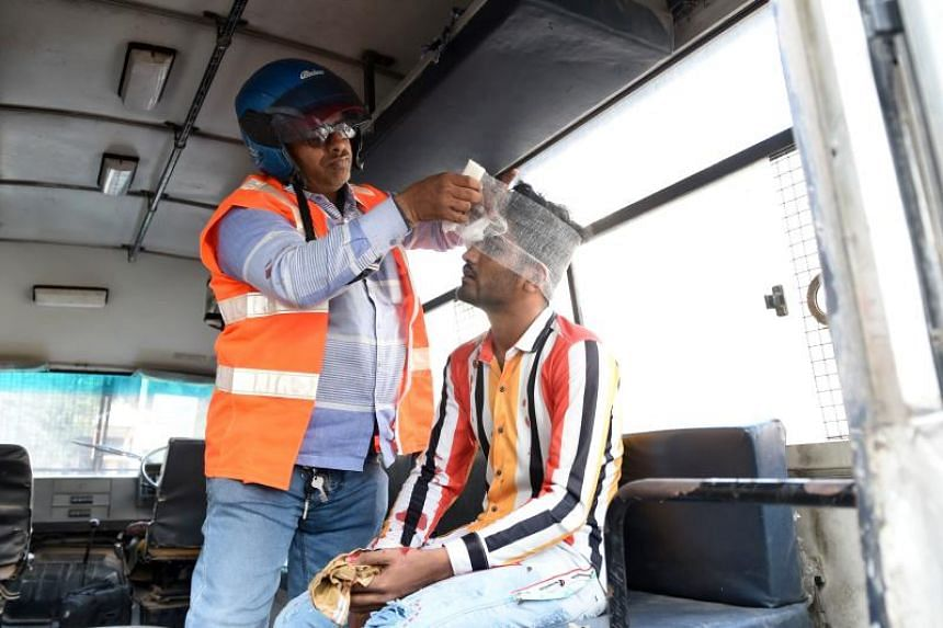 A volunteer provides first aid to a protester inside a police vehicle during a demonstration against India's new citizenship law in Ahmedabad on Dec 19, 2019.