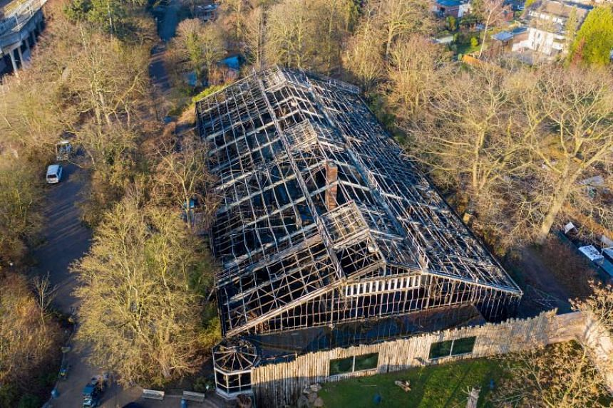 An aerial view of the burned-out monkey house of the zoo in Krefeld, western Germany, on Jan 1, 2020.