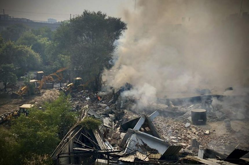 Smoke is seen after a factory caught fire and collapsed in New Delhi's Peera Garhi area on Jan 2, 2020.