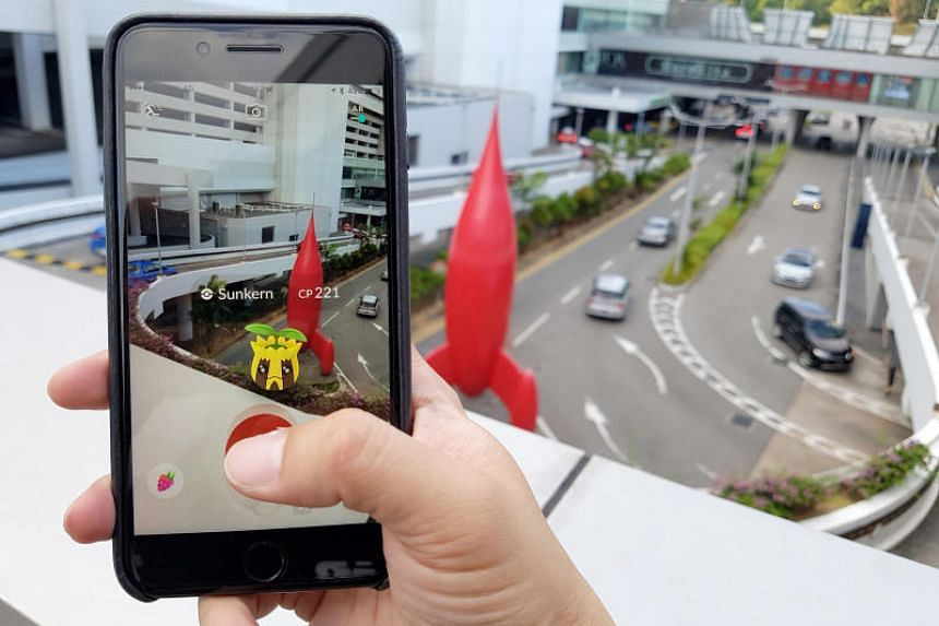 In a picture taken on May 14, 2017, a Pokemon fan plays the location-based augmented reality mobile game, Pokemon Go.