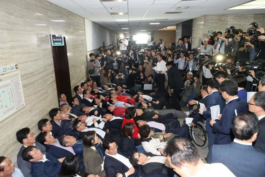 South Korea's opposition party members block access to a committee room in an attempt to stop legislation being passed at the National Assembly in Seoul on April 26, 2019.