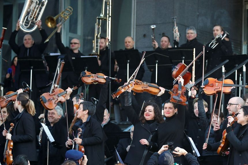 Members of the Paris Opera's orchestra play an improvised open-air concert to protest the government's proposed pension reform.