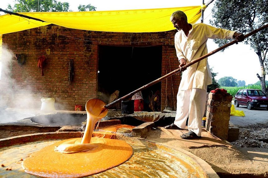 A worker at a jaggery factory in Fatehpur, India. India's manufacturing PMI rose to 52.7 last month, from 51.2 in November.