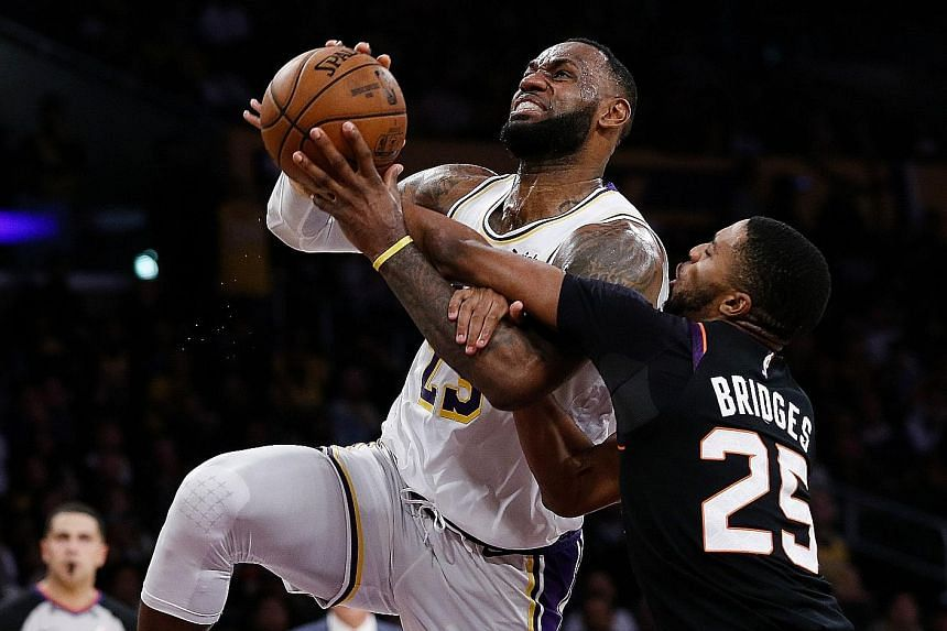 LeBron James getting fouled by Phoenix forward Mikal Bridges. But the Suns could not prevent the LA Lakers star from recording a triple-double.