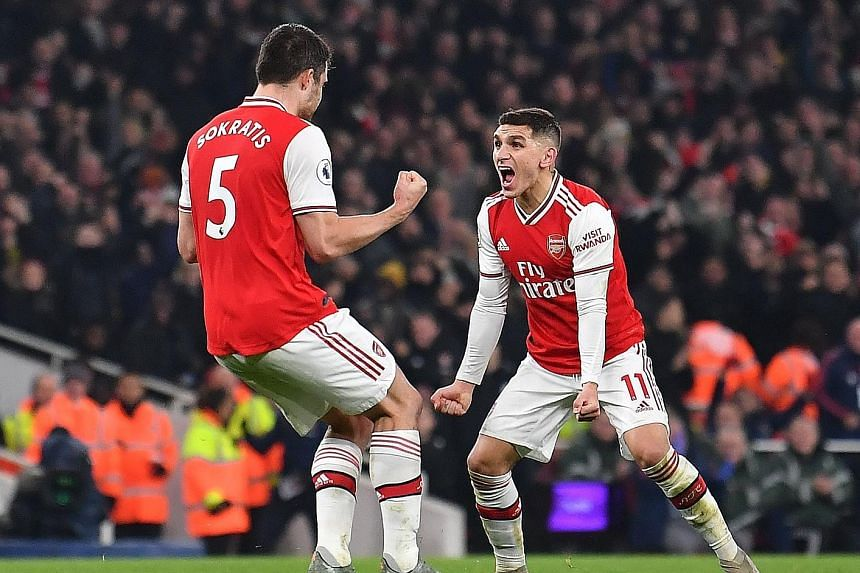Defender Sokratis Papastathopoulos celebrating with Lucas Torreira after scoring Arsenal's second goal against Manchester United in the Premier League on Wednesday. PHOTO: AGENCE FRANCE-PRESSE