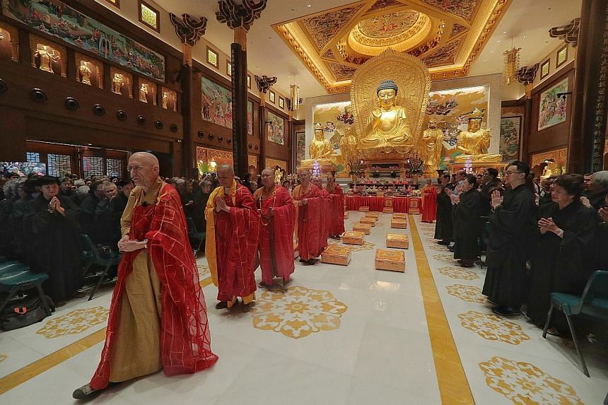 (From left) Venerable Heng Sure, Venerable Yongshou, Venerable Juexing, Venerable Xinguang, Venerable Pu En and Venerable Yanxu conducting the consecration ceremony yesterday for the Singapore Buddhist Lodge's new worship hall and golden Buddha statu