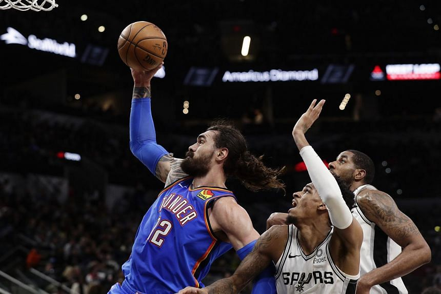 (From left) Oklahoma City Thunder center Steven Adams drives to the basket past San Antonio Spurs guard Dejounte Murray and LaMarcus Aldridge during the first half in San Antonio on Jan 2, 2020.