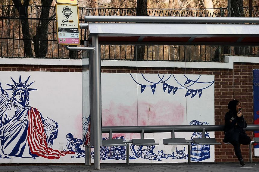 An anti-US mural on the former US embassy's wall in Teheran.