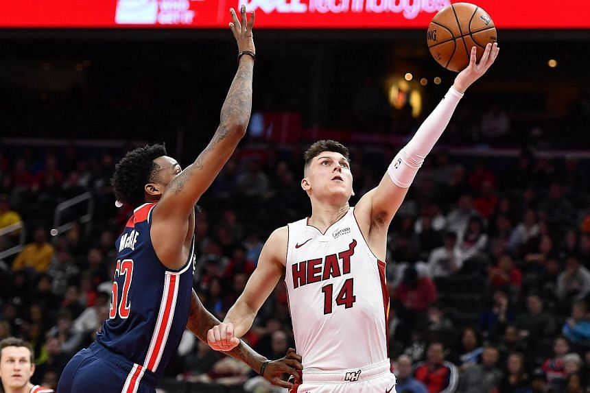 Miami Heat guard Tyler Herro (right) shoots as Washington Wizards guard Jordan McRae defends in Washington on Dec 30, 2019.