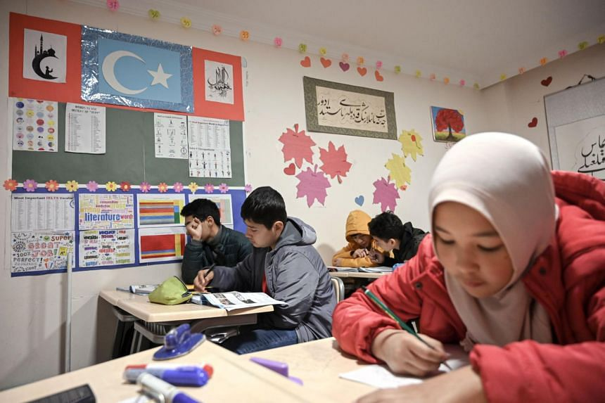 In a photo from Nov 29, 2019, Uighur childen attend a science lesson in a school of Silivri district in Istanbul, Turkey.