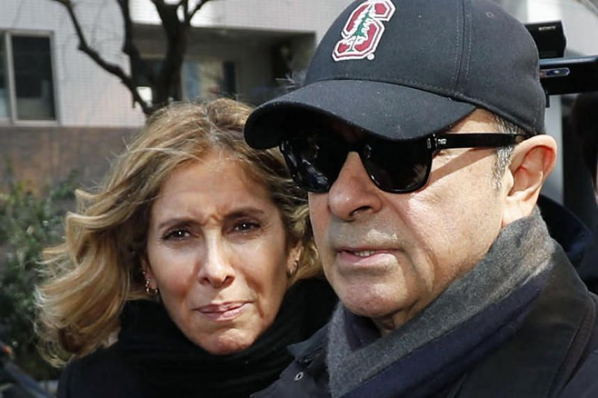 Former Nissan chairman Carlos Ghosn and his wife Carole In a photo taken in March 2019, in Tokyo.