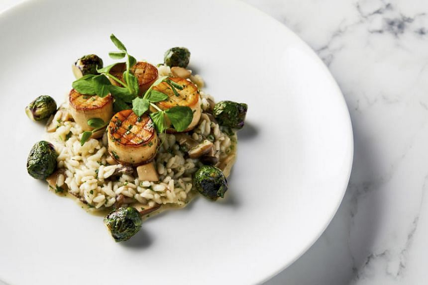 A photo provided by the Golden Globe Awards shows a dish of king oyster mushroom scallops on a bed of wild mushroom risotto with roasted Brussels sprouts, which will be served at the awards ceremony on Jan 5, 2020.
