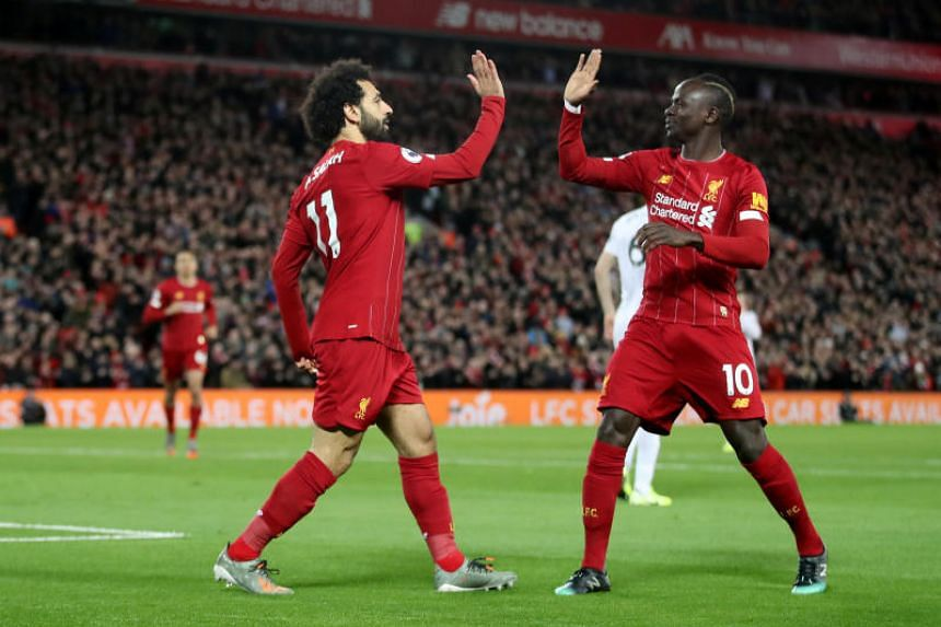 Liverpool's Mohamed Salah (left) celebrates scoring their first goal with teammate Sadio Mane during their EPL football match against Sheffield United at Anfield on Jan 2, 2020.