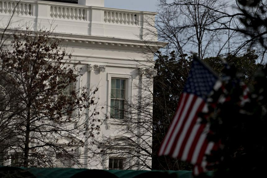 An American flag is displayed in front of the White House in Washington, on Jan 2, 2020.