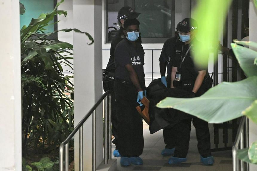 The body being carried out of Esparina Residences in Compassvale Bow, on Jan 3, 2020.