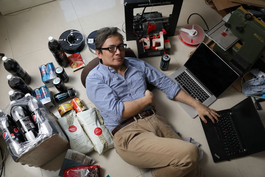 John Lui in his flat, where he stayed indoors over Christmas week to show that it is possible to almost never have to leave one's home as long as one has Internet access, on Jan 3, 2020.
