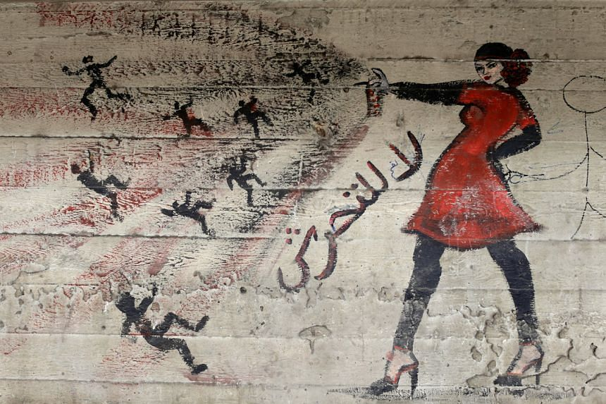 """A mural on a wall in Cairo, Egypt, has script in Arabic that reads """"no harassment"""", in this photo dated May 24, 2013. Surveys indicate the vast majority of Egyptian women feel insecure in the street."""