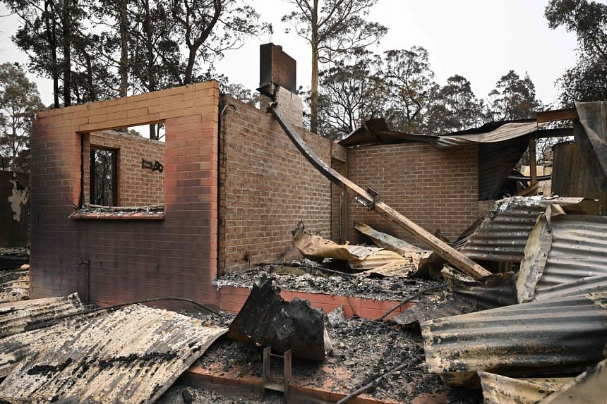 The remains of a house destroyed by a bush fire outside Batemans Bay in New South Wales, on Jan 2, 2020.