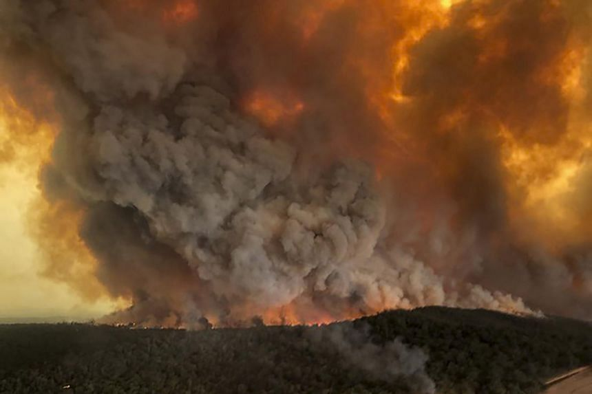 Wildfires rage under plumes of smoke in Bairnsdale, Australia, on Dec 30, 2019.