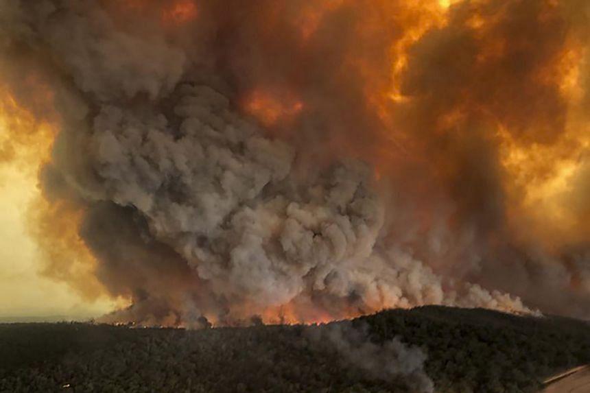Wildfires rage under plumes of smoke in Bairnsdale, Australia, on Dec 30, 2019.