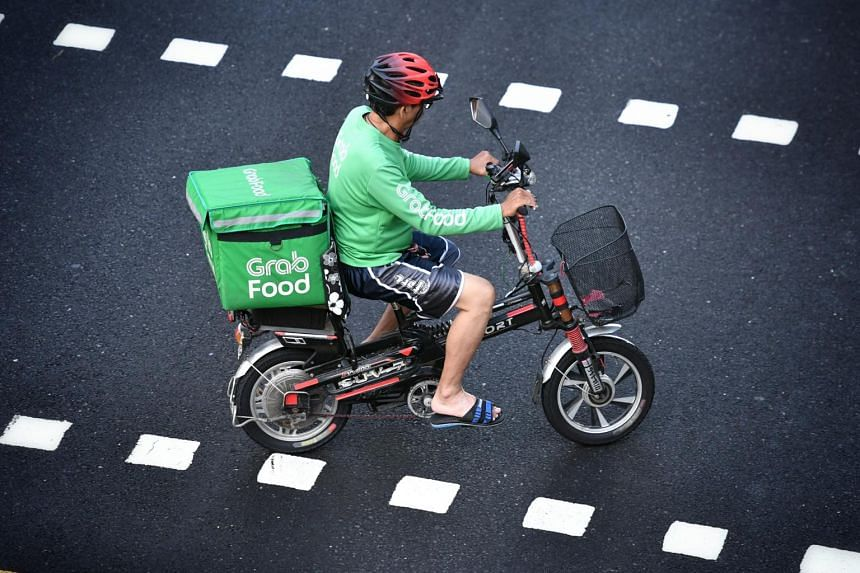 A GrabFood rider on a power-assisted bicycle in Toa Payoh central, on Dec 1, 2019.