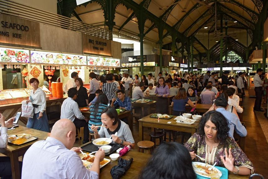 Patrons dining at a hawker centre.