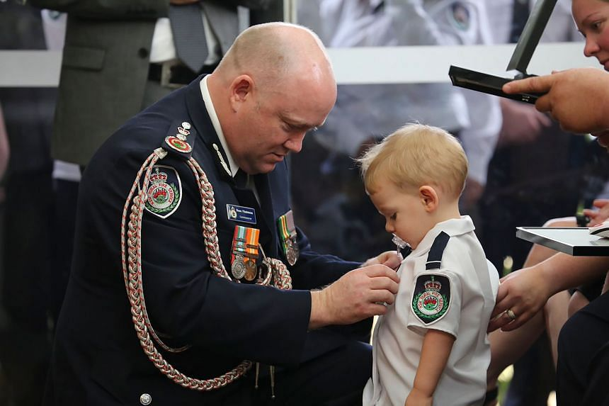 Nineteen-month-old Harvey received the commendation for bravery and service on behalf of his father Geoffrey Keaton from New South Wales Royal Fire Services Commissioner Craig Fitzsimmons at Mr Keaton's funeral on Jan 2, 2020.