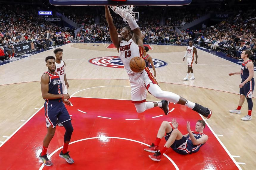 Miami Heat center Bam Adebayo (centre) in action against Washington Wizards guard Troy Brown Jr. (left) and centre Anzejs Pasecniks during their game at Capital One Arena in Washington, DC, on Dec 30, 2019.