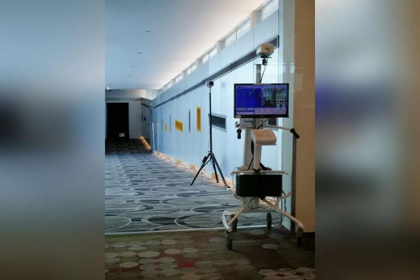 A thermal scanner set up at Changi Airport for incoming Wuhan flights. Travellers have been advised to take precautions, including avoiding contact with live animals and with people who show signs of illness.
