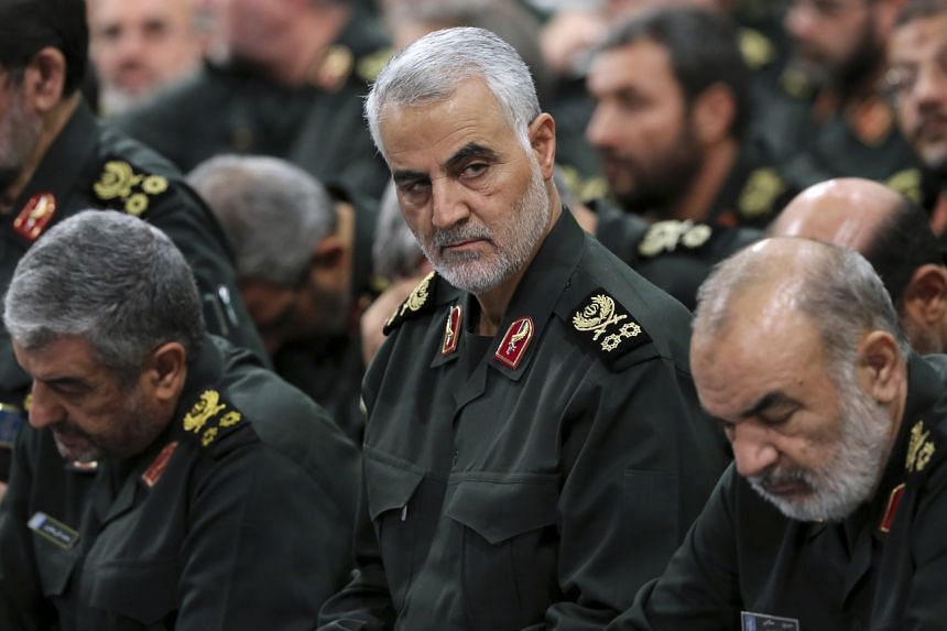 Iranian commander Qassem Soleimani (centre) was killed in a US air strike at Baghdad's international airport.