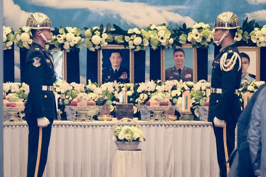 Taiwanese military honour guards stand in front of portraits of the victims killed during a helicopter crash, including chief of the general staff Shen Yi-ming (centre left), at a funeral parlour in Taipei on Jan 3, 2020.