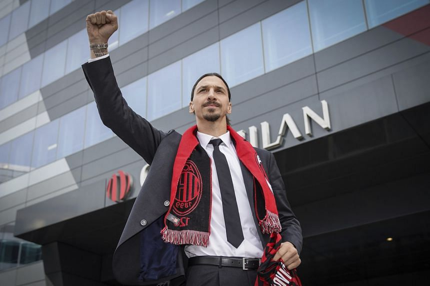 Zlatan Ibrahimovic wears an AC Milan scarf as he acknowledges his fans outside the AC Milan team headquarters in Italy on Jan 3, 2020.