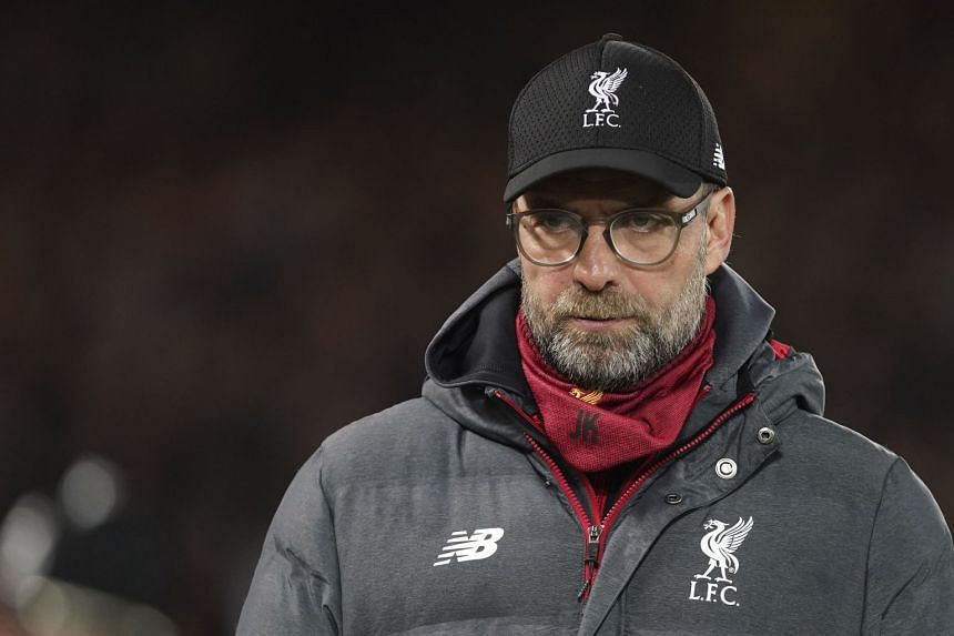 Klopp (above) finds himself down to just 12 senior outfield players, plus new signing Takumi Minamino and a number of youth team members for the Merseyside derby.