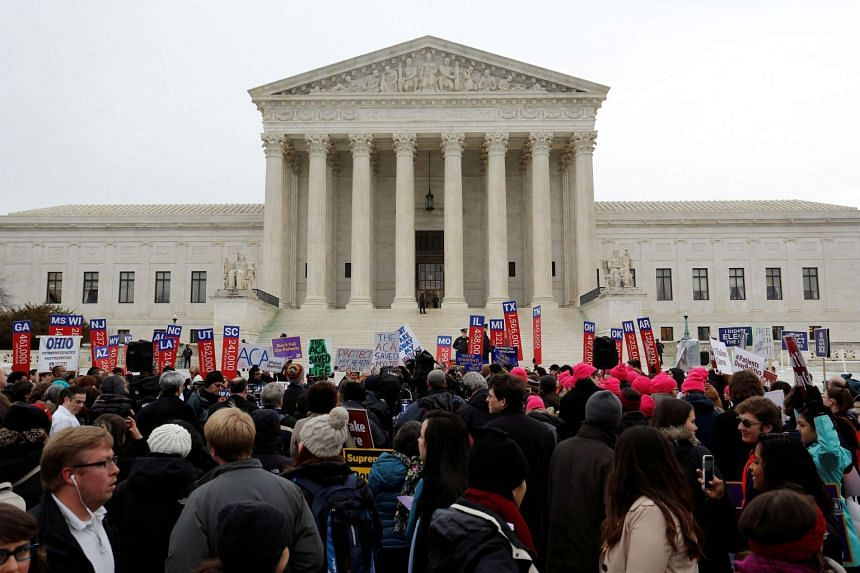 A 2015 photo shows Obamacare supporters gather at the Supreme Court building in Washington.