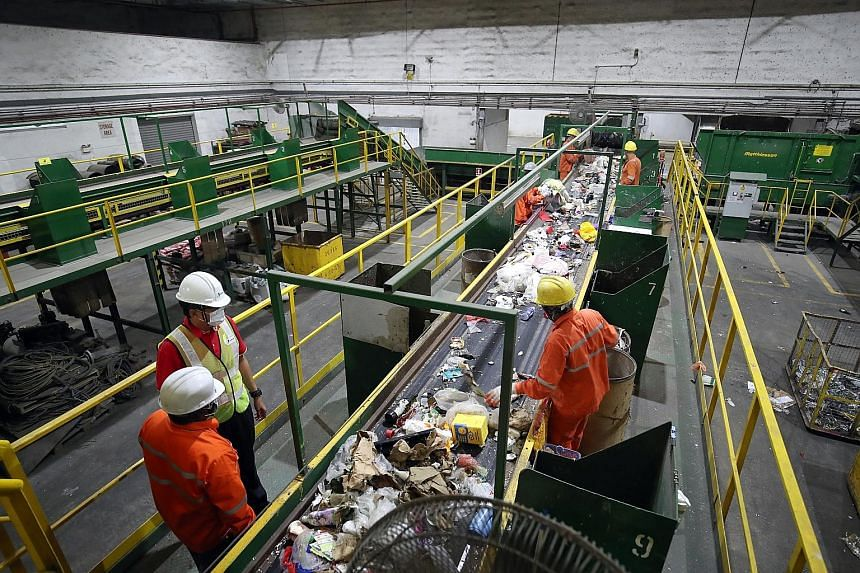 SembWaste's materials recycling facility in Tuas. SembWaste and Veolia ES Singapore are among the four public waste collectors serving six sectors here, according to the National Environment Agency's website.