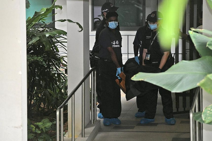 The body of the woman being taken away from the scene yesterday. Residents at the Sengkang condominium had witnessed her arguing with a man before her death.