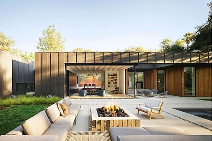 Measuring 5,380 sq ft, the house in the Studio City neighbourhood comprises three separate pavilions connected by glass walkways, with enormous glass doors that slide open to connect the interior to a mosaic of courtyards and gardens.