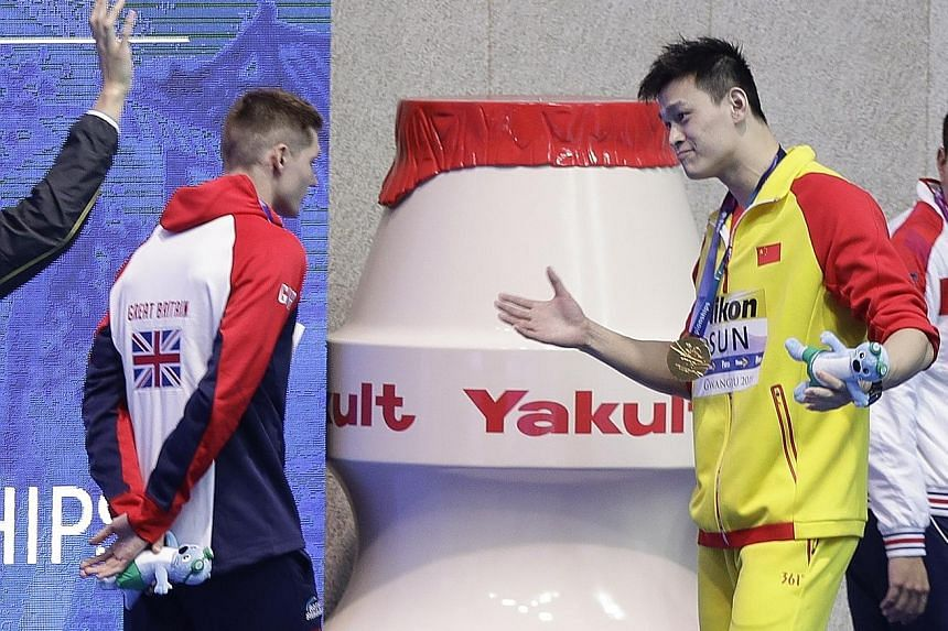 Briton Duncan Scott refusing to pose with 200m freestyle champion Sun Yang on the podium at the world championships in South Korea last July. The snub was over the Chinese star's row with doping testers in September 2018 that led to a smashed blood vial.