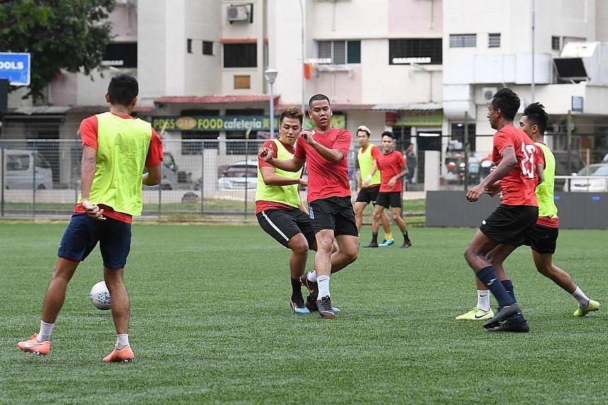 Warriors players training at the Jurong Stadium despite the uncertainties surrounding the team's Singapore Premier League participation next season.