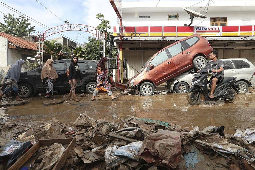 Residents of Bekasi, in eastern Jakarta, returned home to mud and debris as the flood waters receded.