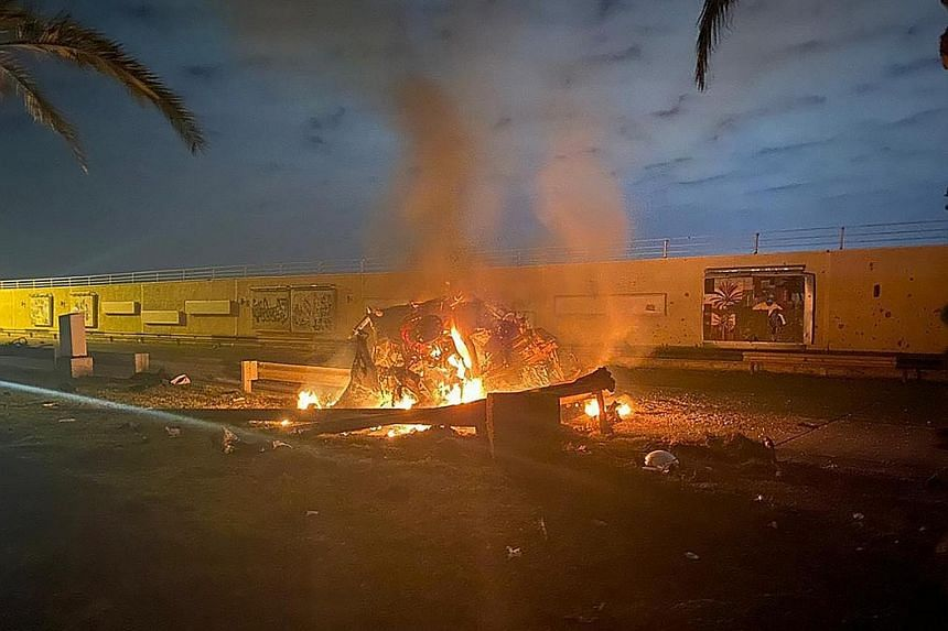 A photo released by the Iraqi Prime Minister Press Office shows a burning vehicle at the Baghdad International Airport following an air strike yesterday. The Pentagon said the US military killed Major-General Qassem Soleimani, commander of Iran's eli
