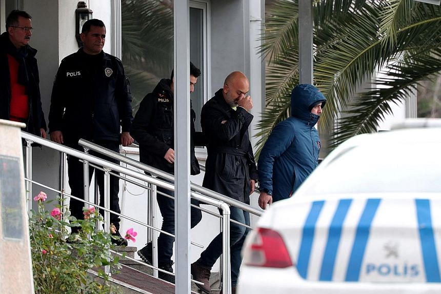 Two people suspected of helping Carlos Ghosn escape being escorted by Turkish police as they left a police station in Istanbul yesterday.