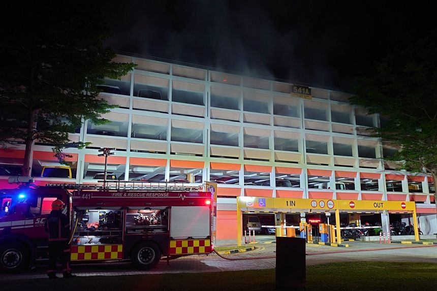 Photos appear to show the flame originating from the third storey of Block 541A Choa Chu Kang Street 52.
